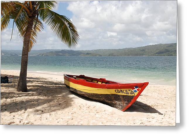 Hispaniola Greeting Cards - A Small Wooden Boat On The Beach Greeting Card by Hibberd, Shannon