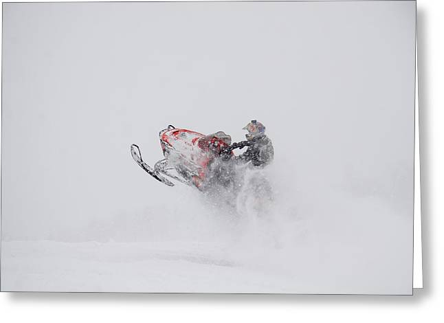 Snowmobile Greeting Cards - A Snowmobiler Jumps From A Hill Greeting Card by Taylor S. Kennedy