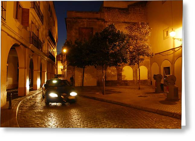 People Of The Night Greeting Cards - A Street Scene With A Car At Night Greeting Card by Raul Touzon