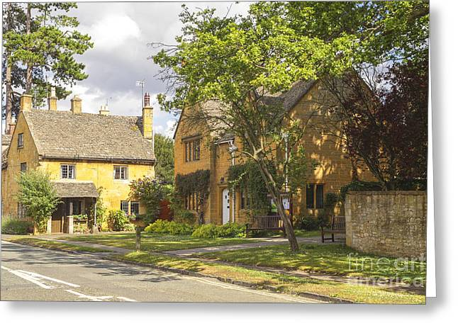 Desirable Greeting Cards - A sunny street in the Cotswolds in England Greeting Card by Patricia Hofmeester