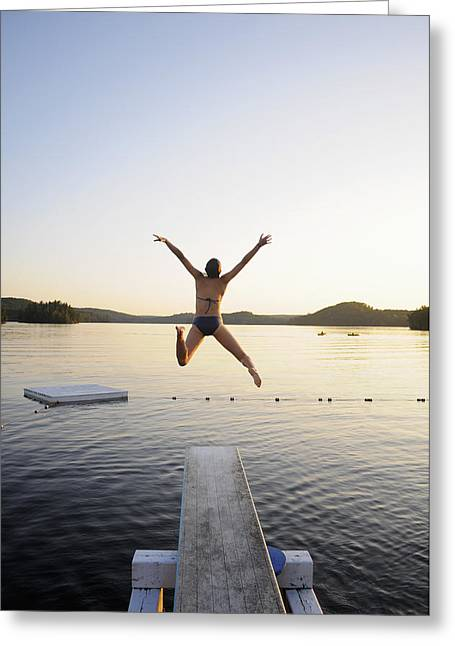 Diving Board Greeting Cards - A Swimmer Jumps Off A Diving Board Greeting Card by James MacDonald