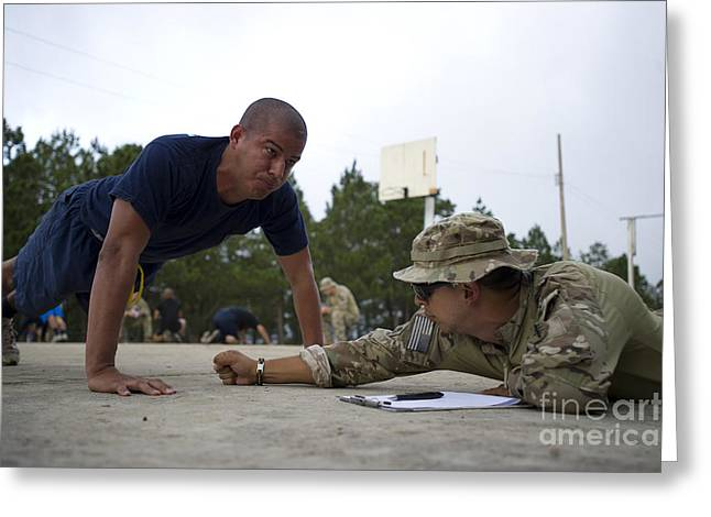 Military Police Greeting Cards - A Tigres Commando Conducts Push-ups Greeting Card by Stocktrek Images