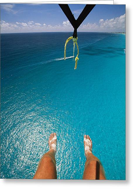 Release Greeting Cards - A Tourist Goes Parasailing In Cancun Greeting Card by Michael Melford