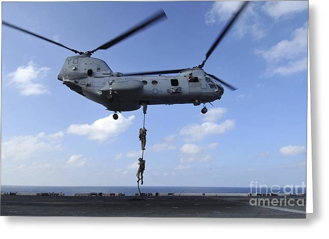 Rotorcraft Photographs Greeting Cards - A Trio Of Marines Fast Rope Greeting Card by Stocktrek Images
