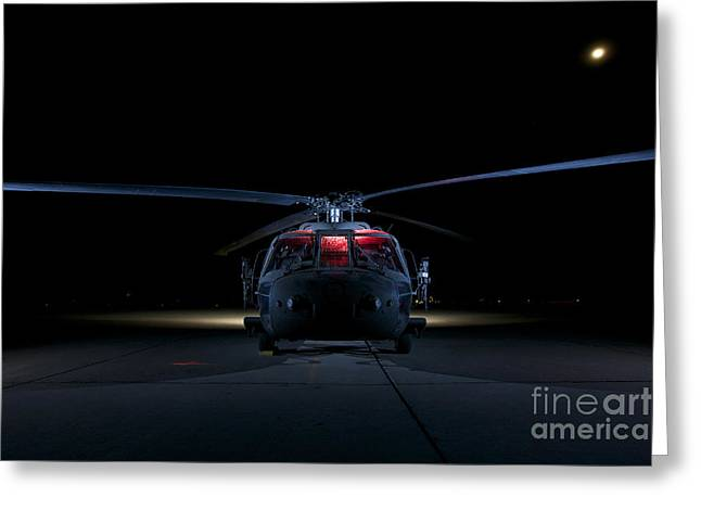 Rotorcraft Photographs Greeting Cards - A Uh-60 Black Hawk Helicopter Lit Greeting Card by Terry Moore
