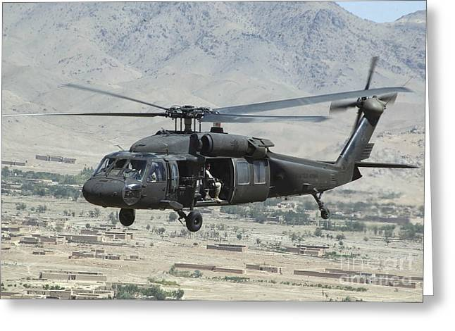 Rotorcraft Photographs Greeting Cards - A Uh-60 Blackhawk Helicopter Greeting Card by Stocktrek Images