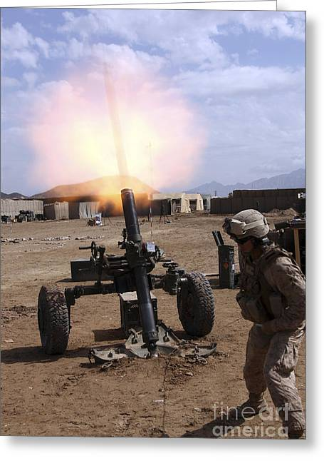 Military Base Greeting Cards - A U.s. Marine Corps Gunner Fires Greeting Card by Stocktrek Images
