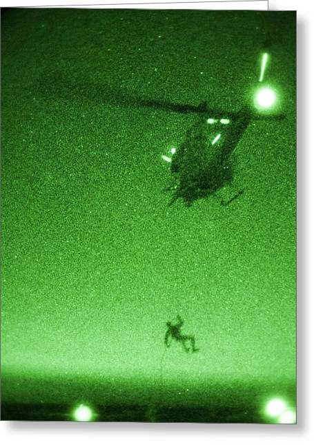 Deployment Greeting Cards - A U.S. Marine rappels from a UH-1N Huey helicopter Greeting Card by Celestial Images