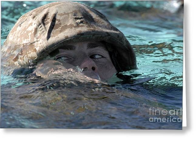 Swimmers Greeting Cards - A U.s. Marine Swims Across A Training Greeting Card by Stocktrek Images