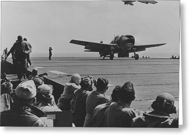 Troops Photographs Greeting Cards - A US Navy Hellcat Fighter Aircraft Landing On The Deck Of A Carrier Greeting Card by American School