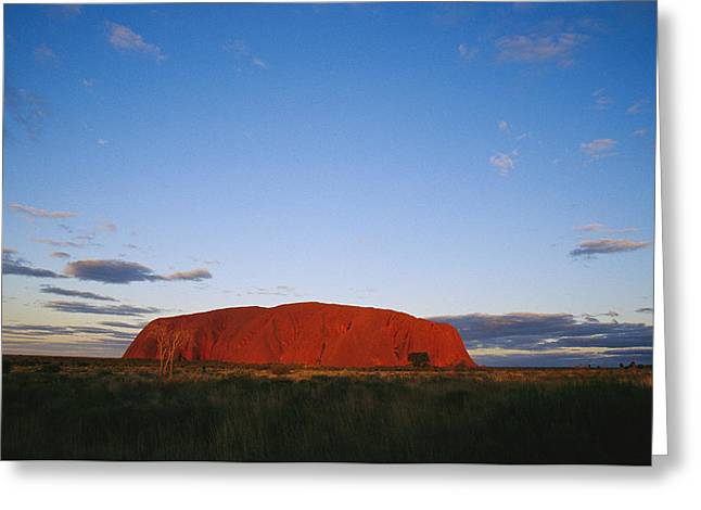 Ayers Rock Greeting Cards - A View Of Ayers Rock Under A Twilight Greeting Card by Jason Edwards