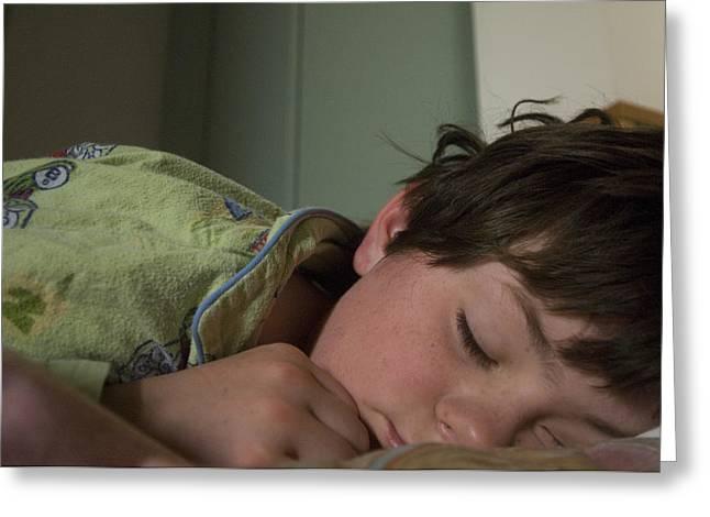 Pajamas Photographs Greeting Cards - A Young Boy Sleeps In Green Pajamas Greeting Card by Joel Sartore