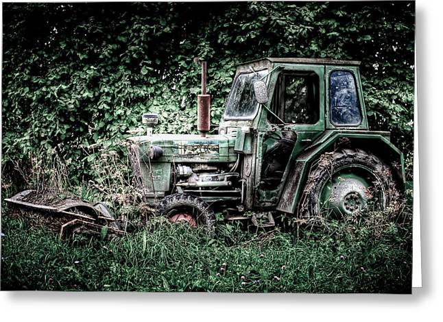 Steel. Grass Greeting Cards - Abandoned Tractor Greeting Card by Gert Lavsen