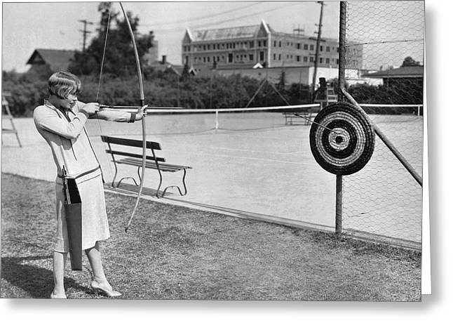 Actress Shooting An Arrow Greeting Card by Underwood Archives