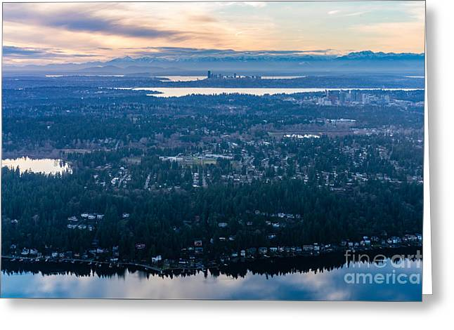 Aerial Seattle And Bellevue Skylines Across Lake Washington And Lake Sammamish Towards The Cascades Greeting Card by Mike Reid