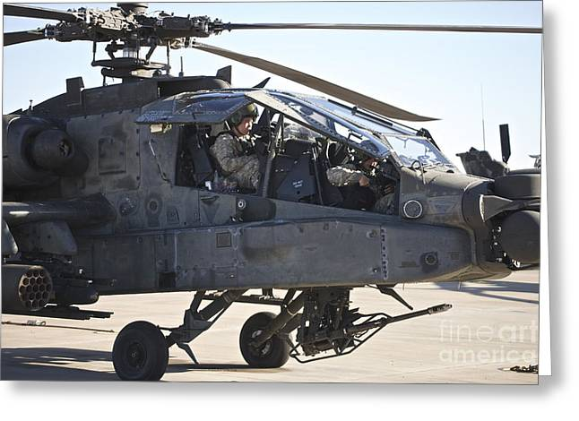 Us Open Photographs Greeting Cards - Ah-64d Apache Longbow Pilot Prepares Greeting Card by Terry Moore