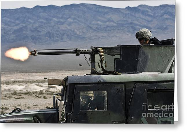 Ammo Greeting Cards - Airman Fires A .50 Caliber Heavy Greeting Card by Stocktrek Images