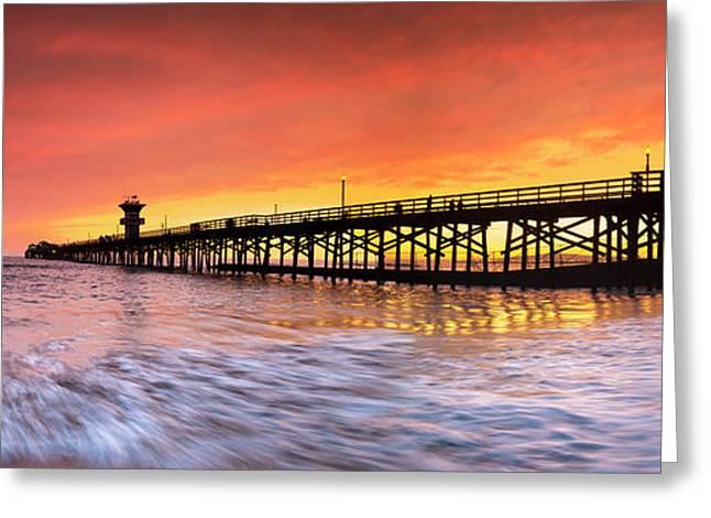 Amber Seal Beach Pier Greeting Card by Sean Davey