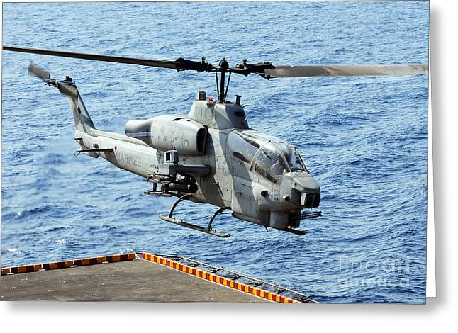 Flight Operations Photographs Greeting Cards - An Ah-1w Super Cobra Helicopter Greeting Card by Stocktrek Images