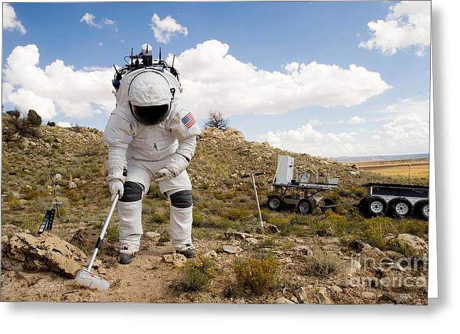 Examining Greeting Cards - An Astronaut Collects A Soil Sample Greeting Card by Stocktrek Images