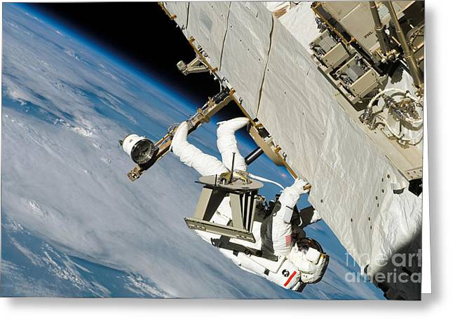 Crawl Greeting Cards - An Astronaut Crawls Along A Truss Greeting Card by Stocktrek Images