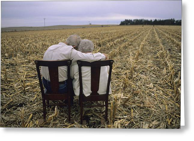 Farmers And Farming Greeting Cards - An Elderly Couple Embrace Greeting Card by Joel Sartore