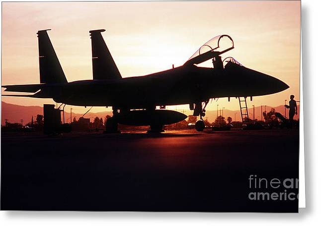 Iraq Greeting Cards - An F-15c Eagle Aircraft Silhouetted Greeting Card by Stocktrek Images