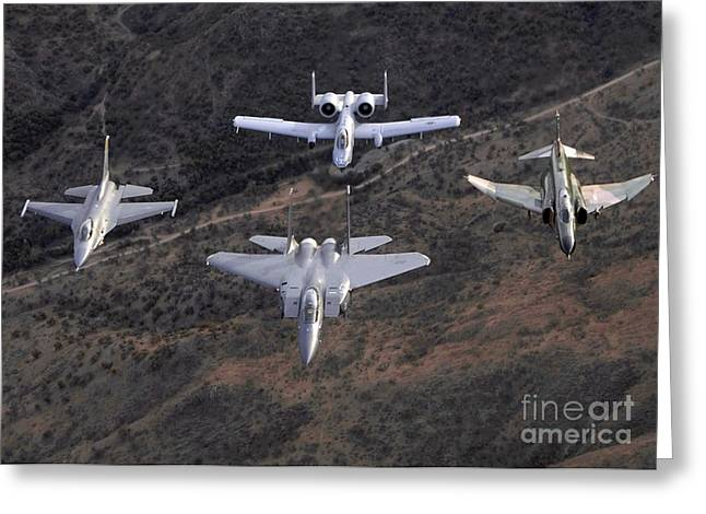 Aerobatics Greeting Cards - An F-16 Fighting Falcon, F-15 Eagle Greeting Card by Stocktrek Images