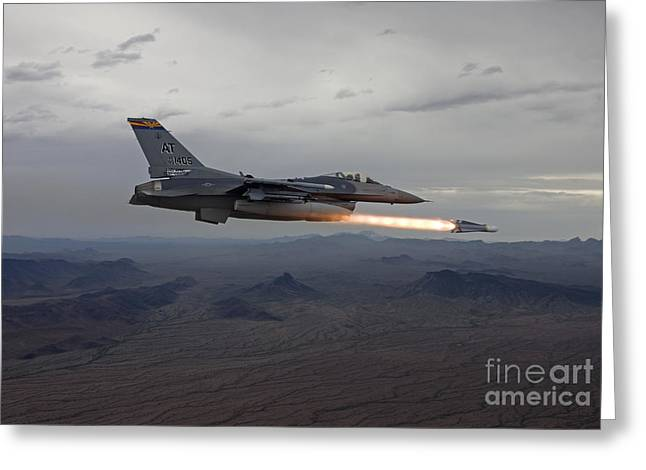 Shooting Guard Greeting Cards - An F-16 Fighting Falcon Fires An Agm-65 Greeting Card by HIGH-G Productions