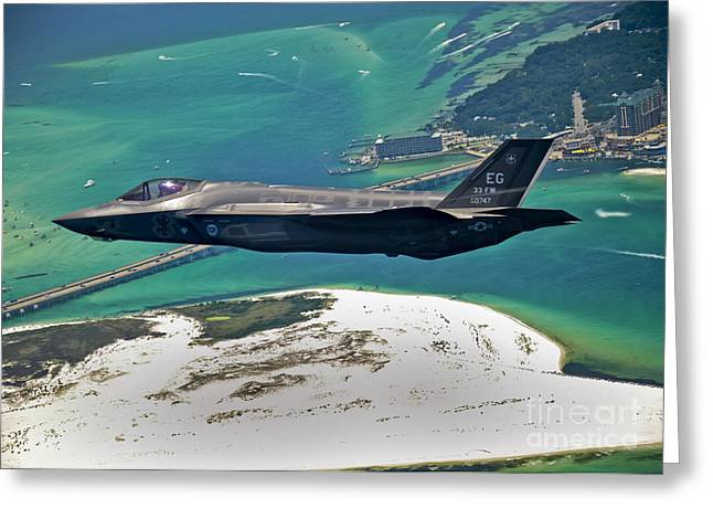 Military Airplanes Photographs Greeting Cards - An F-35 Lightning Ii Flies Over Destin Greeting Card by Stocktrek Images