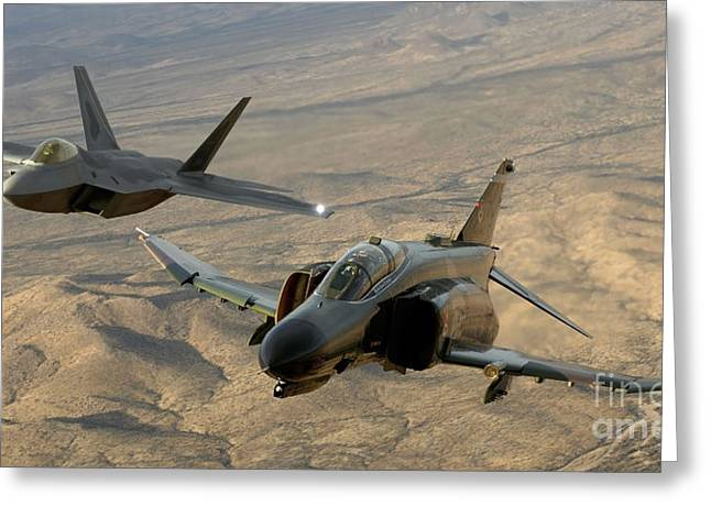 Flying Planes Greeting Cards - An F-4 Phantom And An F-22a Raptor Fly Greeting Card by Stocktrek Images