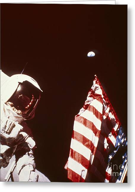 Apollo Program Greeting Cards - Apollo 17 Astronaut On Moon With Flag Greeting Card by NASA / Science Source