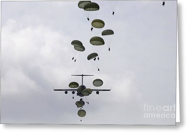 Freight Aircraft Greeting Cards - Army Soldiers Jump Out Of A C-17 Greeting Card by Stocktrek Images