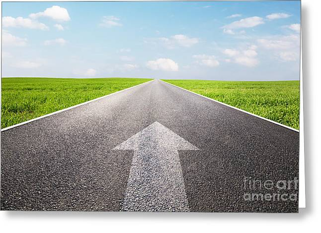 Street Race Greeting Cards - Arrow sign pointing forward on long empty straight road Greeting Card by Michal Bednarek