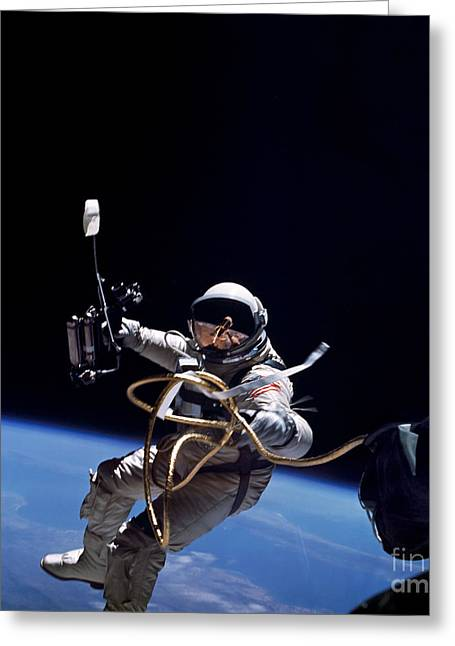 Weightless Greeting Cards - Astronaut Floats In Space Greeting Card by Stocktrek Images