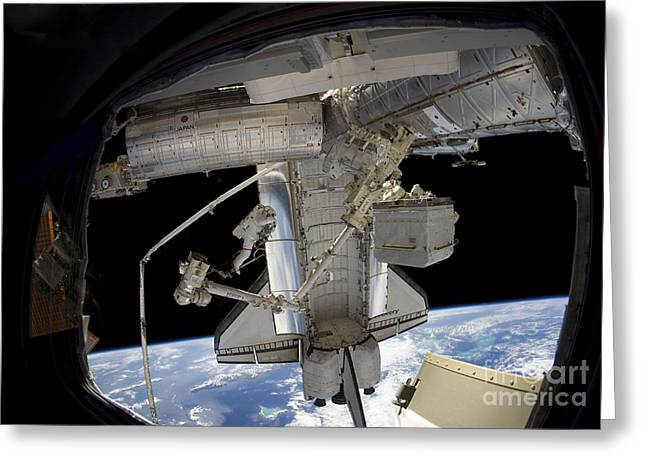 View From Space Greeting Cards - Astronaut Participates In A Spacewalk Greeting Card by Stocktrek Images