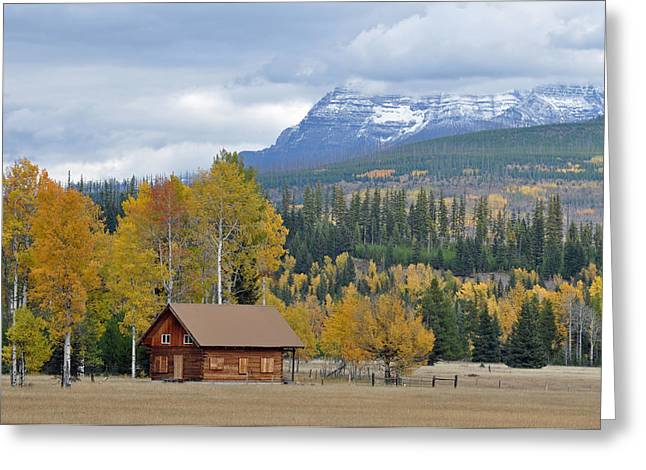 Snow-covered Landscape Photographs Greeting Cards - Autumn Mountain Cabin in Glacier Park Greeting Card by Bruce Gourley