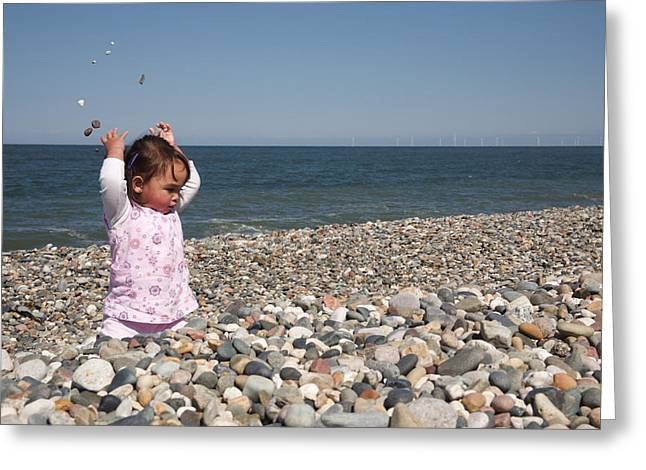Throwing Stones Greeting Cards - Baby on the beach.  Greeting Card by Christopher Rowlands