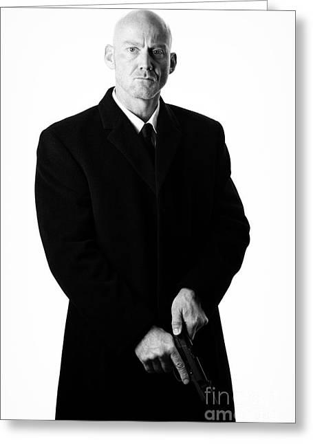 Henchman Photographs Greeting Cards - Bald Headed Man Wearing Heavy Black Overcoat Cocking Automatic Handgun Greeting Card by Joe Fox