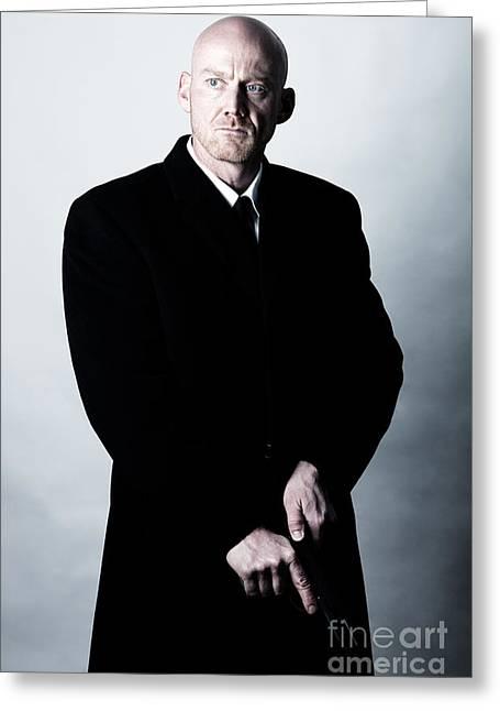 Henchman Photographs Greeting Cards - Bald Headed Man Wearing Heavy Black Overcoat Cocking Automatic Handgun Model Released Image Greeting Card by Joe Fox