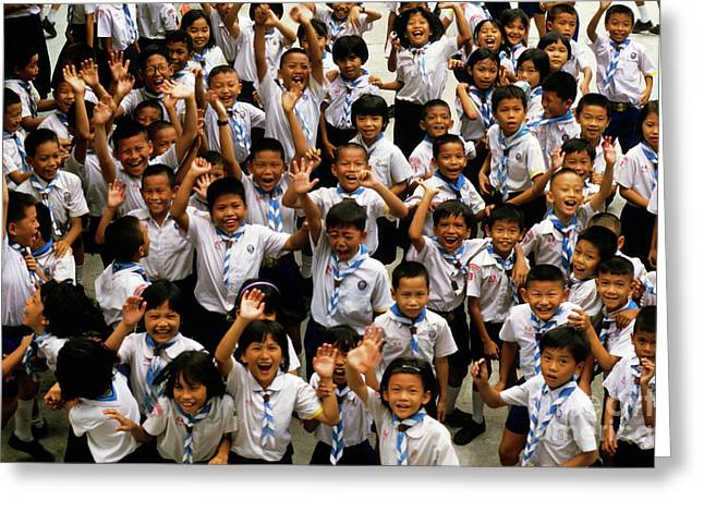 Toothy Smile Greeting Cards - Bangkok school children jumping and smiling at the camera Greeting Card by Sami Sarkis