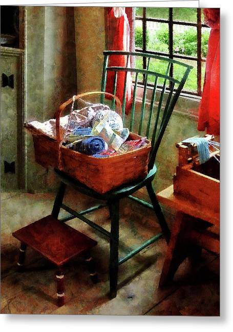 Basket Of Cloth And Yarn On Chair Greeting Card by Susan Savad
