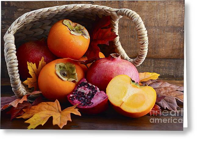 Tabletop Greeting Cards - Basket of fresh persimmons and pomegranates Greeting Card by Milleflore Images