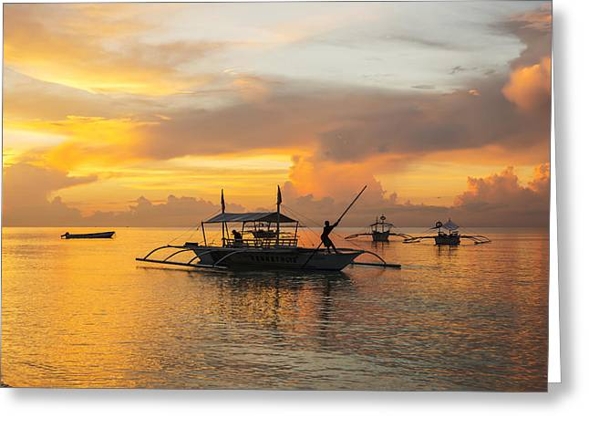 Boats In Reflecting Water Photographs Greeting Cards - Beautiful Sunrise In Alona Beach, A Man Greeting Card by Luis Martinez