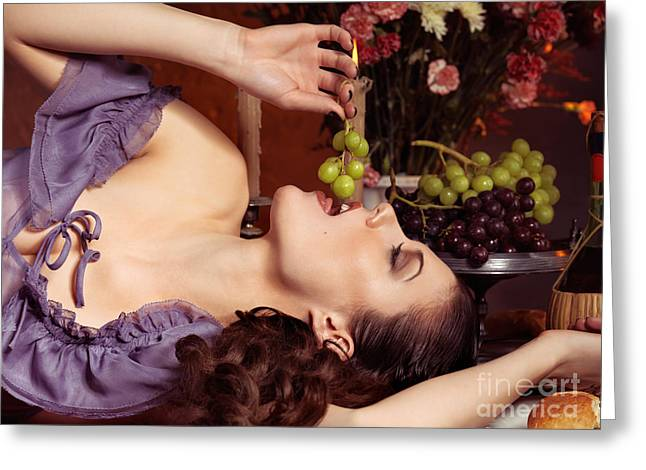 Festivities Greeting Cards - Beautiful Woman Eating Grapes on a Festive Table Greeting Card by Oleksiy Maksymenko