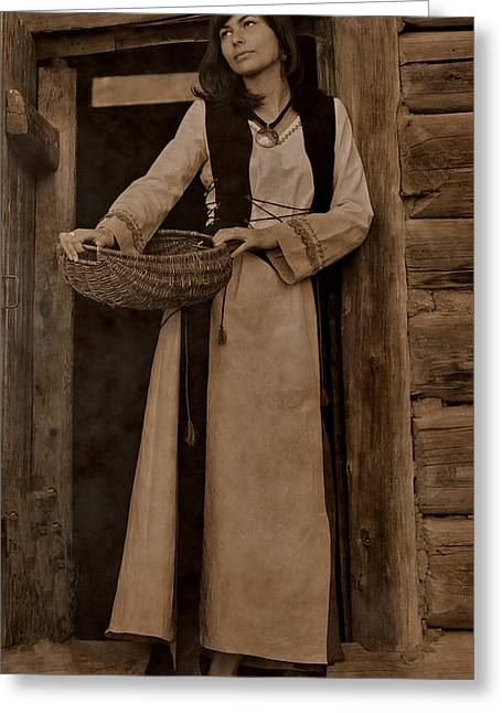 Log Cabins Greeting Cards - Beautiful Young Woman With Dark Hair In A Black Velvet Historical Dress Is Standing At The Door Of A Greeting Card by Jozef Klopacka