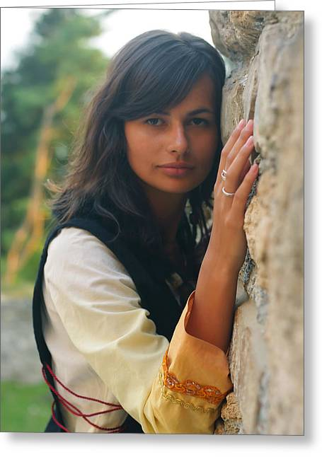 Mystical Landscape Greeting Cards - Beautiful Young Woman With Long Dark Hair And A Historical Dress At A Rough Ancient Stone Wall Greeting Card by Jozef Klopacka