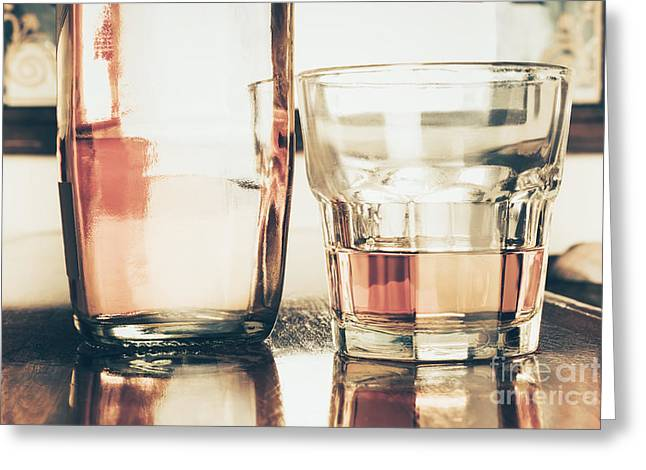 Glass Table Reflection Greeting Cards - Beverage picture on a glass of golden rum 50ml Greeting Card by Ryan Jorgensen