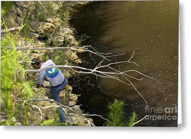 Doline Greeting Cards - Biologist Inspecting Sinkhole Greeting Card by Inga Spence