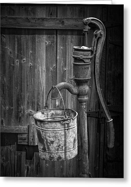 Faucet Greeting Cards - Black and White Still Life of Rusty Water Pump with Bucket Greeting Card by Randall Nyhof